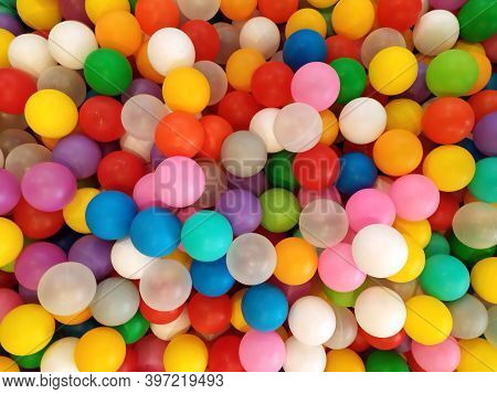 Colored Balls. Bright Background Colors. Top View Of Many Colorful Balls In The Ball Pool On The Ind