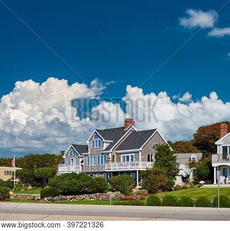 United States flag at suburban neighborhood. New Hampshire, USA.