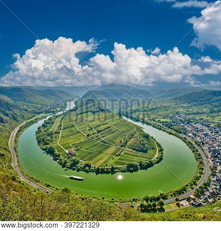 Moselle River bend near Bremm town, Germany. Hills with vineyards, river loop and road along the river. Meander of the Moselle.