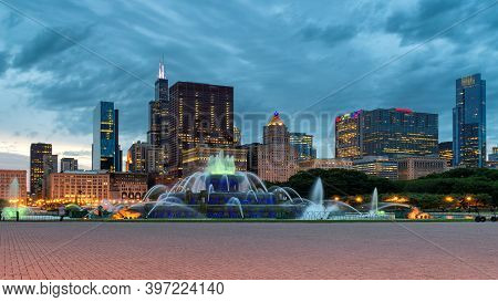 Buckingham Fountain In Chicago City Panorama At Sunset With Skyscrapers, Chicago, Illinois, Usa.