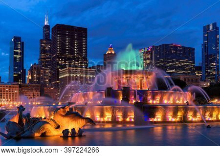 Buckingham Fountain At Night And Chicago Downtown, Chicago, Illinois, Usa.