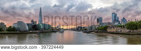 Panoramic View Of London Skyline Along The Thames River During Sunset Time, London, United Kingdom.