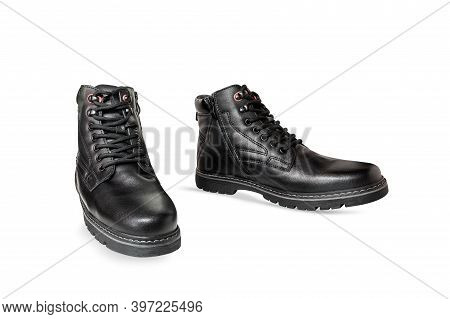 Pair Of Black Genuine Leather Boots. Men's Clothing. Isolated Over White Background.