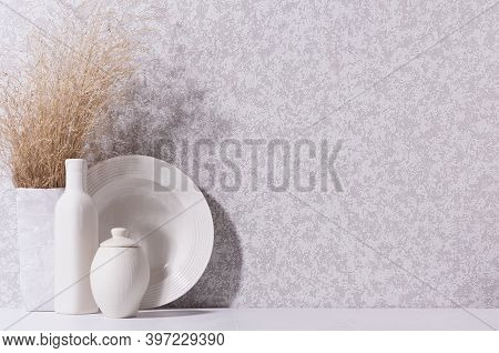 Elegant Home Decor With White Ceramic Crockery, Bottle And Beige Bouquet With Dried Grass On White W