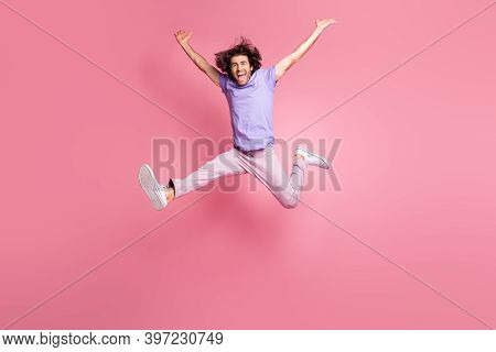 Full Size Photo Of Energetic Young Man Raise Hands Jump In Air Success Wear Pink Pants Isolated On P