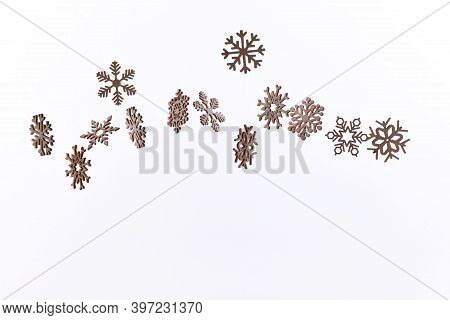 Snowflake Pattern With Falling Snowflakes On A White Background With Copy Space