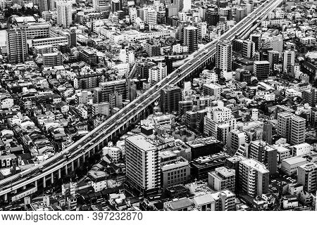 Top View Cityscape. Highway Through The City. Populous City With Skyscrapers. Black And White Archit