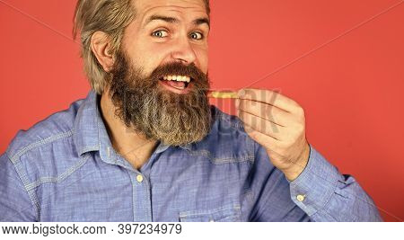 French Fries At The Street Food Market. Bearded Guy Having Snack. Lazy Man Enjoying Junk Food. Man W