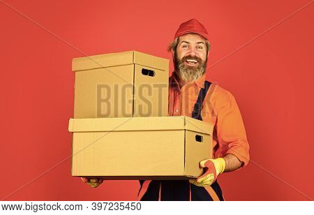 Living Excellence. New House At Moving Day. Man Builder In Boilersuit Hold Boxes. Moving To New Apar