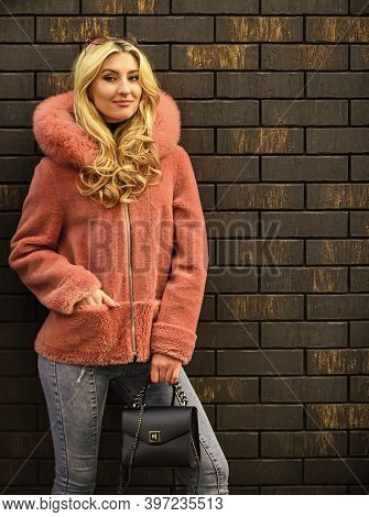 Natural Wool Sheepskin Coat. Fur On Hood. Stay Warm And Fashionable. Glamorous Lady. Woman Wear Furr