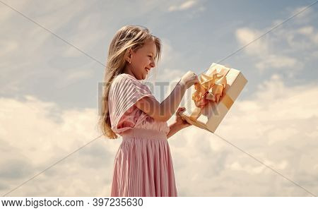 Perfect Day. Holding Gift In Hand. Smiling Little Girl With Shopping Gift. Black Friday Sale. Holida