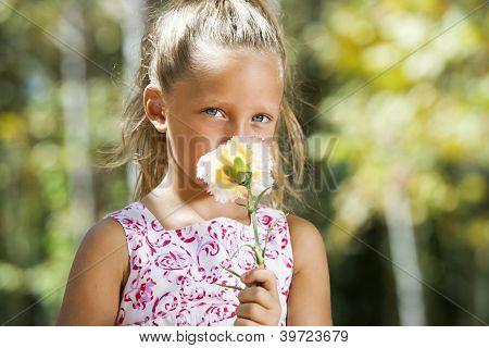 Blue Eyed Girl Hiding Behind Flower.