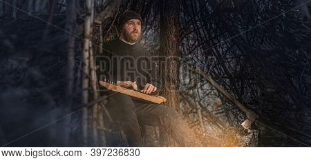 A Bearded Man -a Tramp, A Forester Or A Hermit, Built A Hut Out Of Branches With An Axe In The Fores