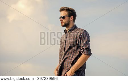 Ultraviolet Protection Concept. Man Eyewear Model Outdoors Blue Sky Background. Handsome Guy Wear Su