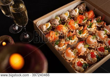 Champagne, Tartlets, Seafood Salads. Cardboard Box With Food With Home Delivery. Gift For Holiday, P