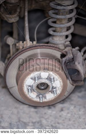 Rear Strut, Wheel Hub And Disc Brake Assembly On An Used Car, View With Removed Wheel In Selective F