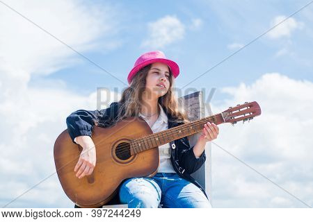 Her Perfect Style. Happy Childhood. Cute Child Play Guitar Outdoor. Music And Song. Vocal School. Be