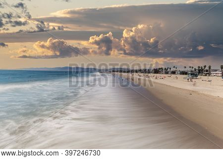 Venice Beach with motion blur water and sunset sky in Los Angeles, California.