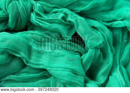 Classic Green Wavy Delicate Cotton Scarf Or Shawl Made Of Wrinkled Fabric. Italian Clothing Style