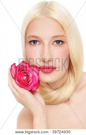 Portrait of young beautiful fresh blond woman with pink rose in her hand, on white background