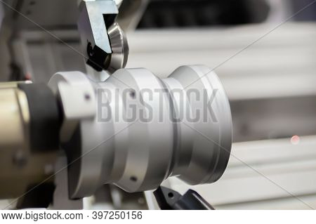 Automatic Cnc Turning Milling Machine Cutting Metal Workpiece At Factory, Plant, Exhibition. Metalwo