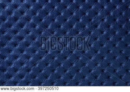 Texture Of Navy Blue Leather Background With Capitone Pattern, Macro. Indigo Textile Of Retro Cheste