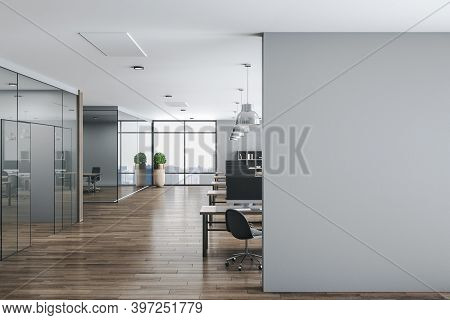Modern Office Interior Hall With Computers On Table And Blank Wall.  Workplace And Corporate Concept