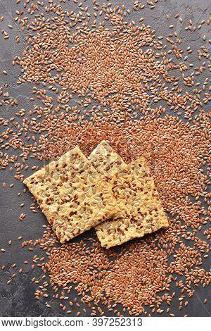 Multigrain Crunchy Crispbread On A Dark Background.