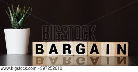Text Bargain On Wooden Cubes Blue Background. Business Concept.