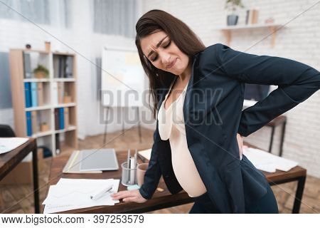 Pretty Pregnant Girl Is Experiencing Labor In Office. Pregnant In Office.