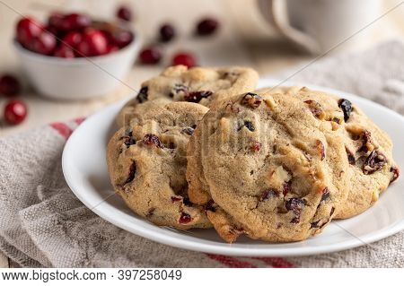 Cranberry Walnut Cookies On A Plate With Bowl Of Cranberries In Background