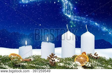 Two Candles On An Advent Wreath Burns With Wintery Background And Snow