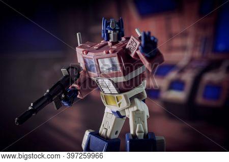NOV 25 2020: Recreation of a scene fromThe Transformers with Optimus Prime ready to battle Decepticons - Hasbro  R.E.D. Robot Enhanced Design action figure