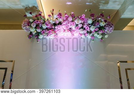 Composition Of Bouquets Of Flowers In Pastel Colors In The Photo Zone. Wedding Preparation, Decorati