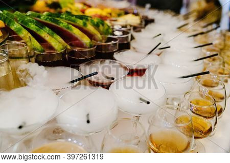 Different Colored Alcohol Cocktails On A Open Air Party, Martini, Vodka With Bubbles On Wedding Tabl