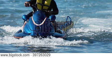 Lifeguard On A Jet Ski Patrols The Beach An Ocean Safety Lifeguard Riding A Jet Ski