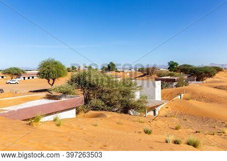Al Madam Ghost Town Landscape, Village Buildings Buried In Sand Dunes, Hunted By Evil Djinn, Abandon