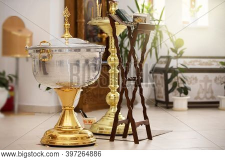 The Interior Of The Orthodox Church. Font For Orthodox Baptism. Background Accessory For The Adoptio