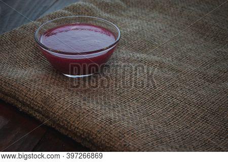 Viburnum Jam In Glass Bowl On The Sackcloth. Minimalism Concept