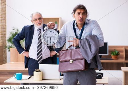 Old boss and his male secretary employee in time management conc