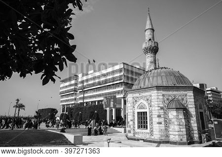 Izmir, Turkey - February 5, 2015: Konak Square View With Ancient Camii Mosque, Ordinary People Walk