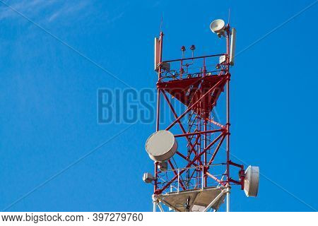 A Cell Phone Tower 4g 5g. Internet Connection With A Blue Sky On The Background