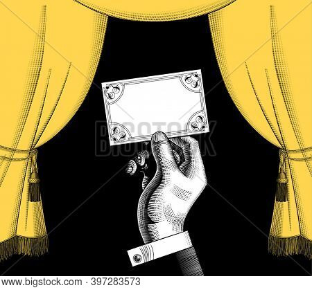 Decorative frame with a yellow curtain in old style and a hand holding a visiting card on black background. Vintage engraving stylized drawing.