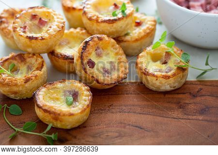 Mini Ham And Cheese Quiches Freshly Baked On A Marble Board Ready To Eat