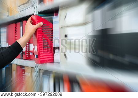 Mans Hand Picking A Blank Blind Folder With Files From The Shelf. Archival, Stacks Of Documents At T