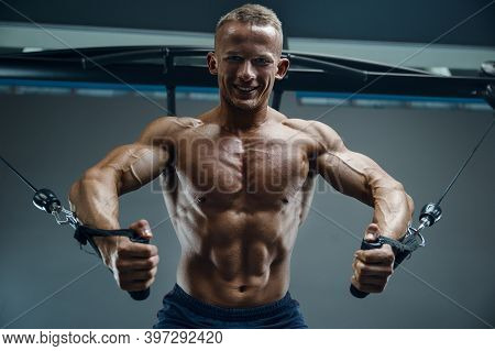 Bodybuilder Handsome Strong Athletic Good Looking Man Pumping Up Chest Muscles Workout Fitness And B