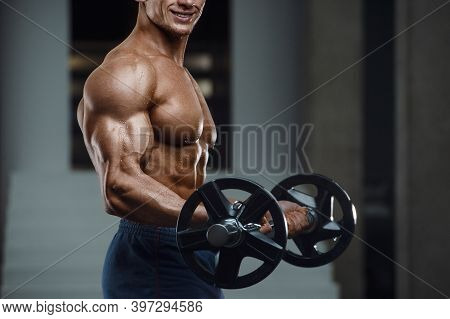 Caucasian Man Pumping Up Muscles. Fitness Training