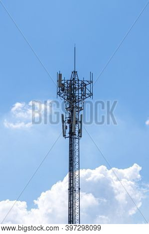 Communication Tower Top. Radio Antenna Tower , Microwave Antenna Tower On Light Sky Background. Wire