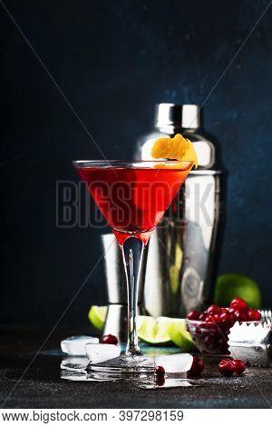 Classic Alcoholic Cocktail Cosmopolitan With Vodka, Liqueur, Cranberry Juice, Lime, Ice And Orange Z