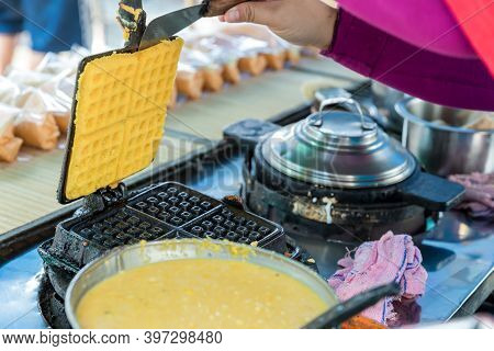 Waffle Iron In The Kitchen. Preparing Homemade Waffles. Preparing Of Tasty Waffles In Modern Make.
